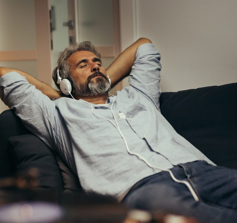 Man relaxing with headphones