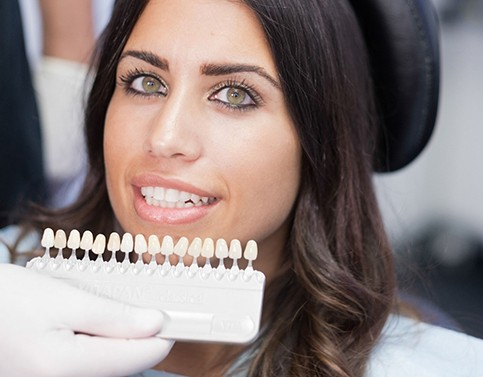 woman smiling with porcelain veneers in Edison